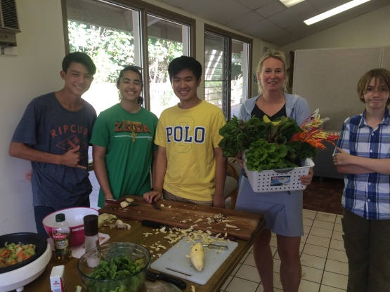 Nicole with the CSA basket (From left to right: Kainoa, Miranda, Edwin, Nicole, and Jackson)